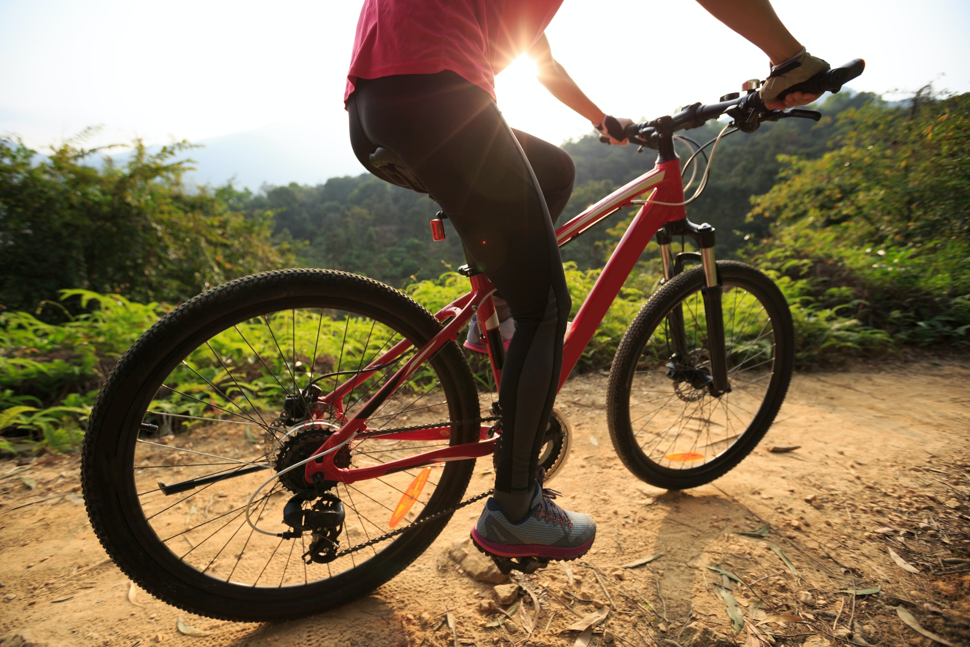 Riding mountain bike on sunrise trail